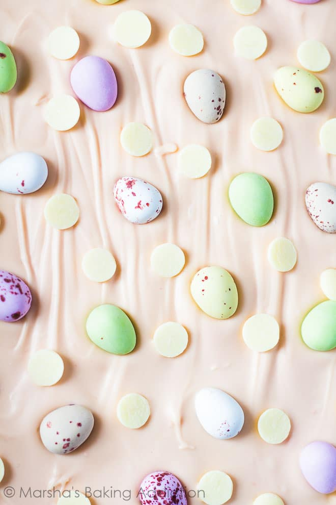 Overhead shot of White Chocolate Easter Bark topped with Mini Eggs and white chocolate chips.
