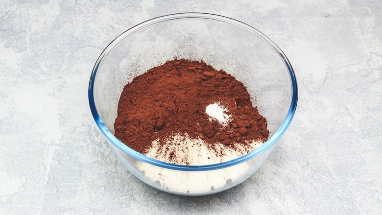 Butter, sugar, cocoa powder, and salt in a mixing bowl.