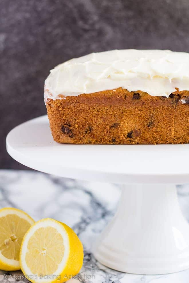 Chocolate Chip Lemon Bread served on a white cake stand.