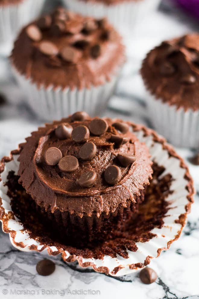 A frosted Double Chocolate Cupcake with wrapper peeled off.
