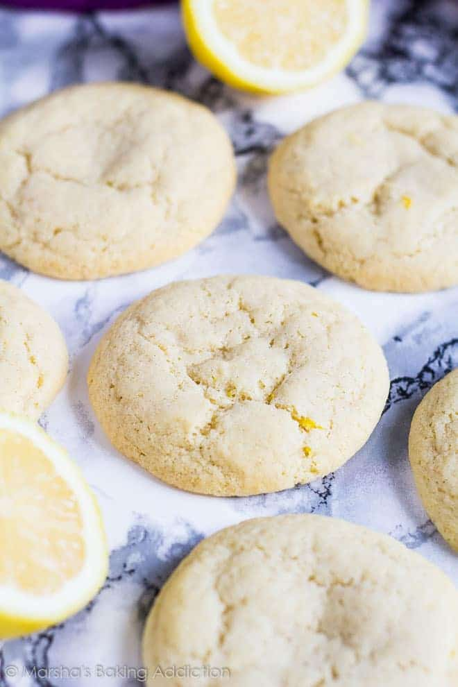 Soft and Chewy Lemon Cream Cheese Cookies on a marble background.