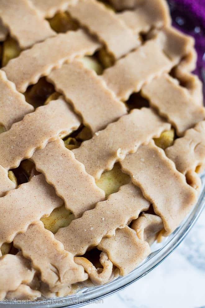 Overhead close-up of lattice top on unbaked Homemade Apple Piein glass pie dish.