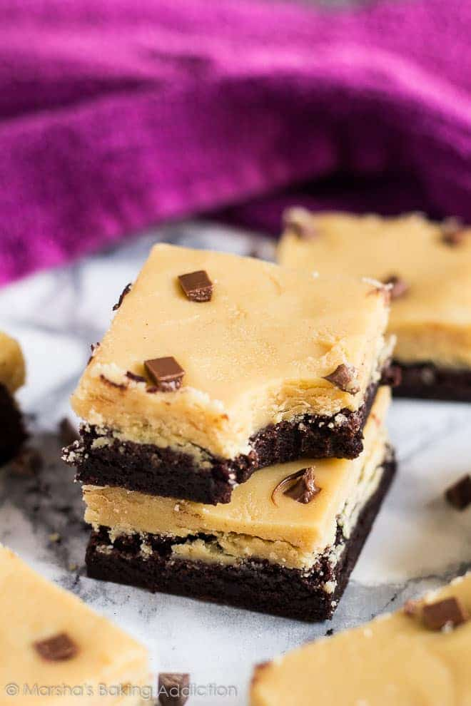 A stack of two Peanut Butter Fudge Brownies with a bite taken out of the top brownie.