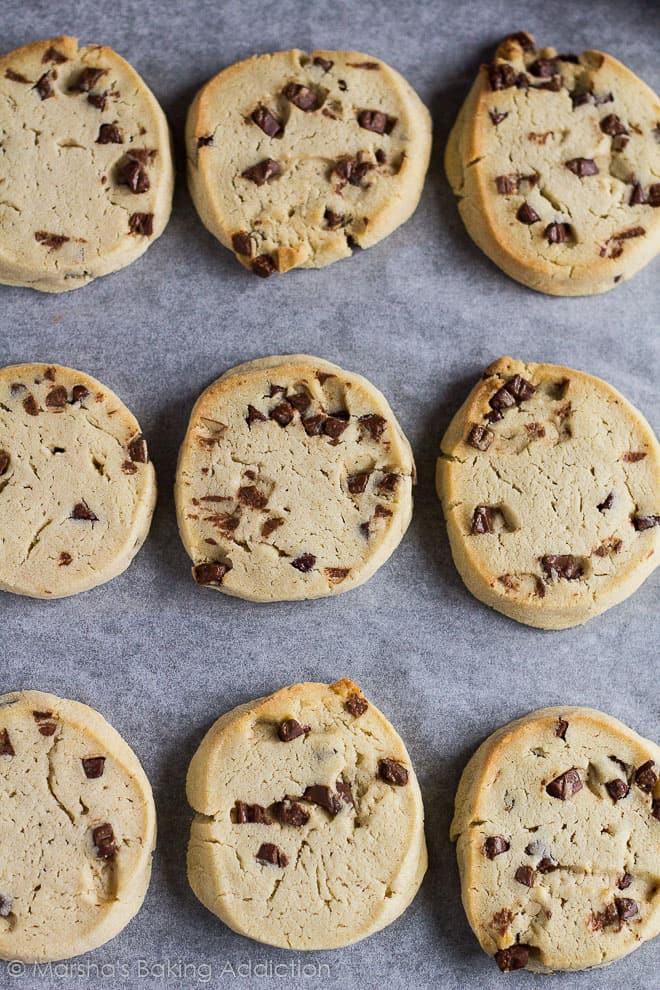 Overhead shot of Chocolate Chip Slice 'n' Bake Cookies on baking tray lined with parchment paper.