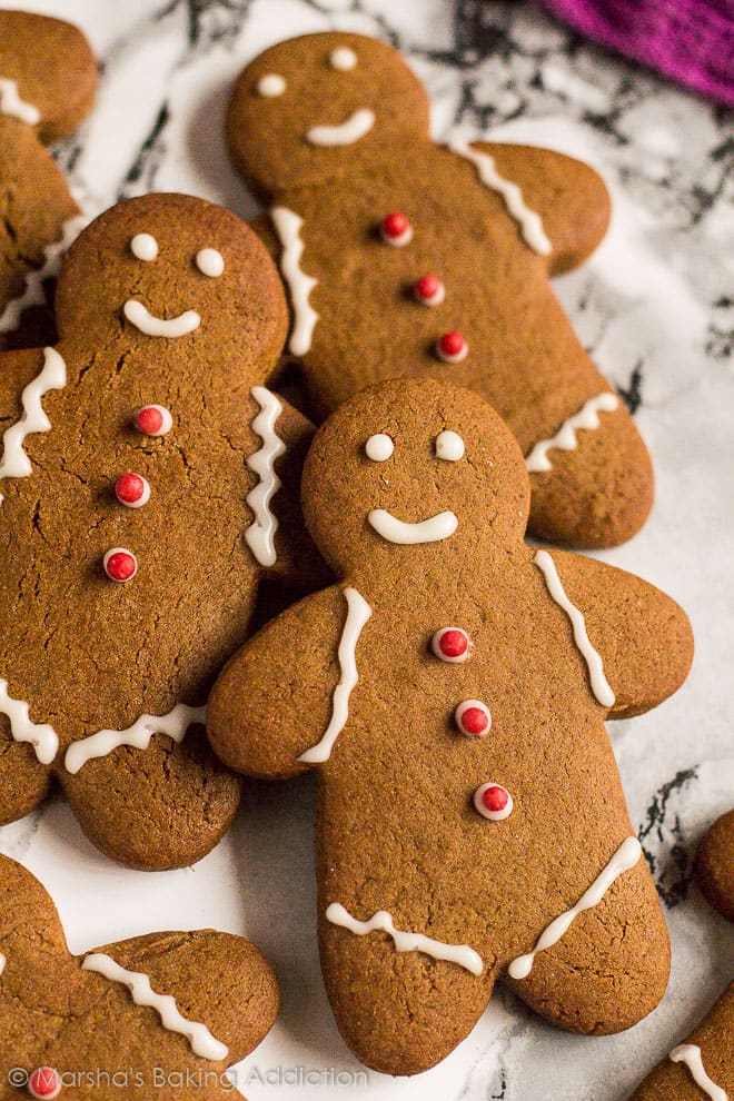 Close-up of iced gingerbread men on marble background.