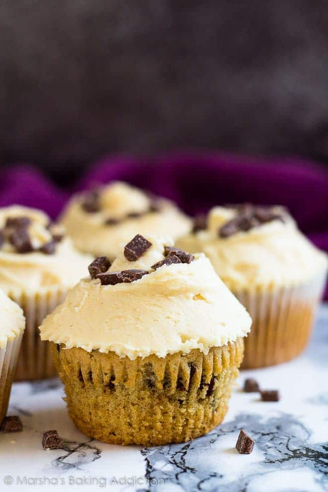 Chocolate Chip Peanut Butter Cupcakes- Deliciously moist and fluffy peanut butter cupcakes studded with chocolate chips, and topped with a creamy peanut butter frosting!