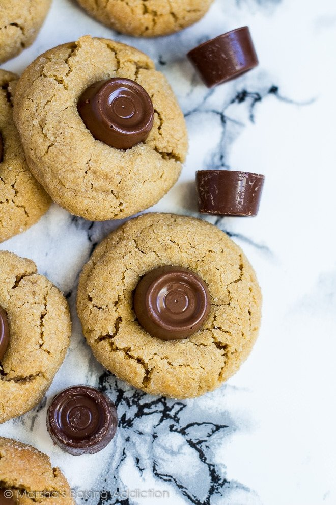 Overhead shot of Rolo peanut butter blossom cookies on marble background.