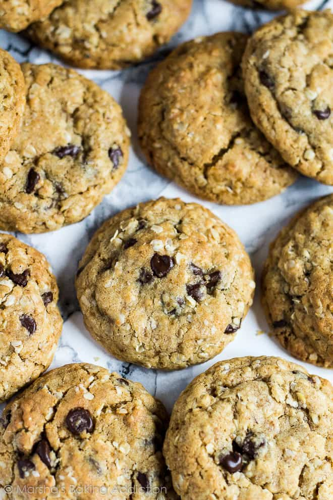 Overhead shot of healthier chocolate chip cookies on marble background.