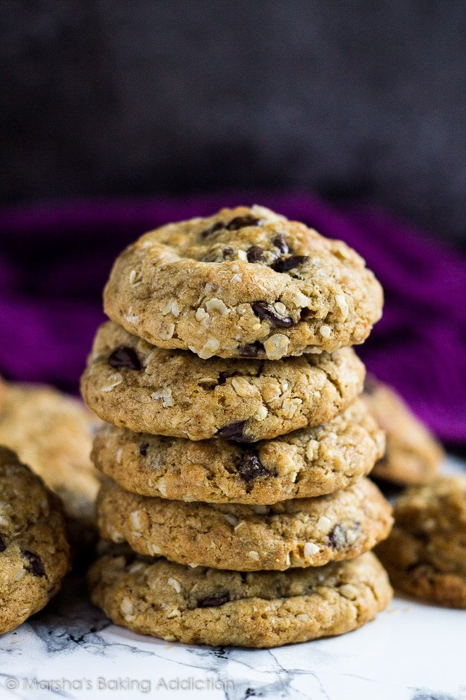 A stack of healthier chocolate chip cookies on marble background.