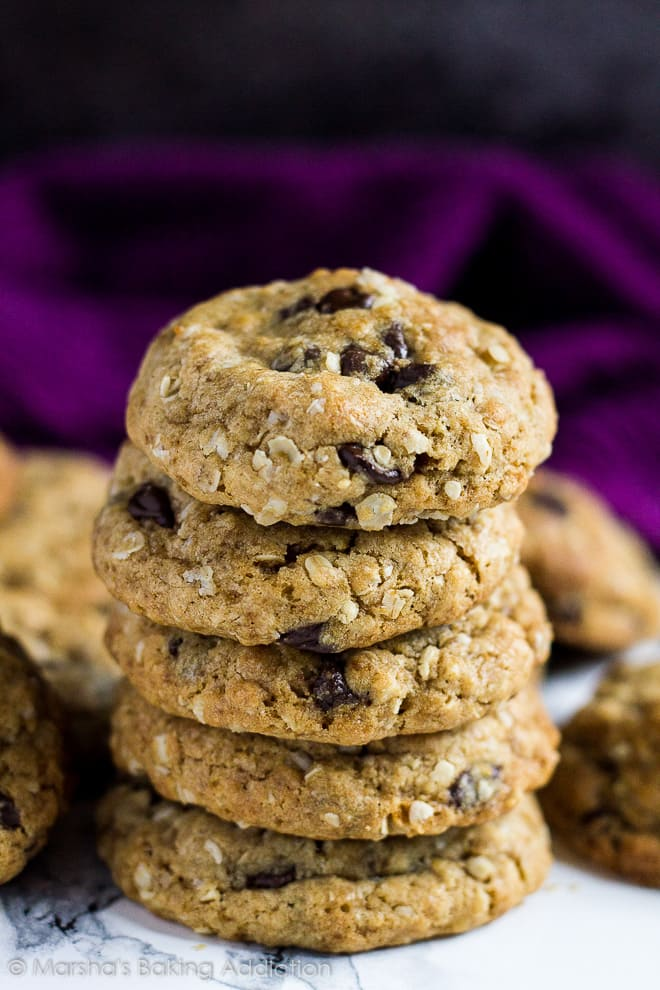 Stack of healthier chocolate chip cookies on marble background.