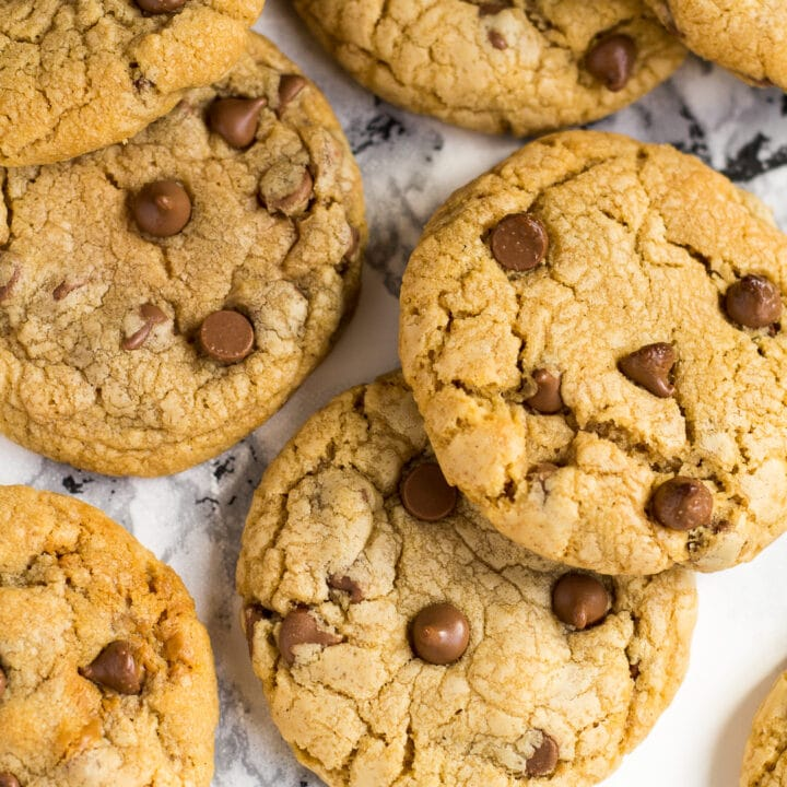 Overhead shot of chocolate chip Biscoff cookies on marble background.