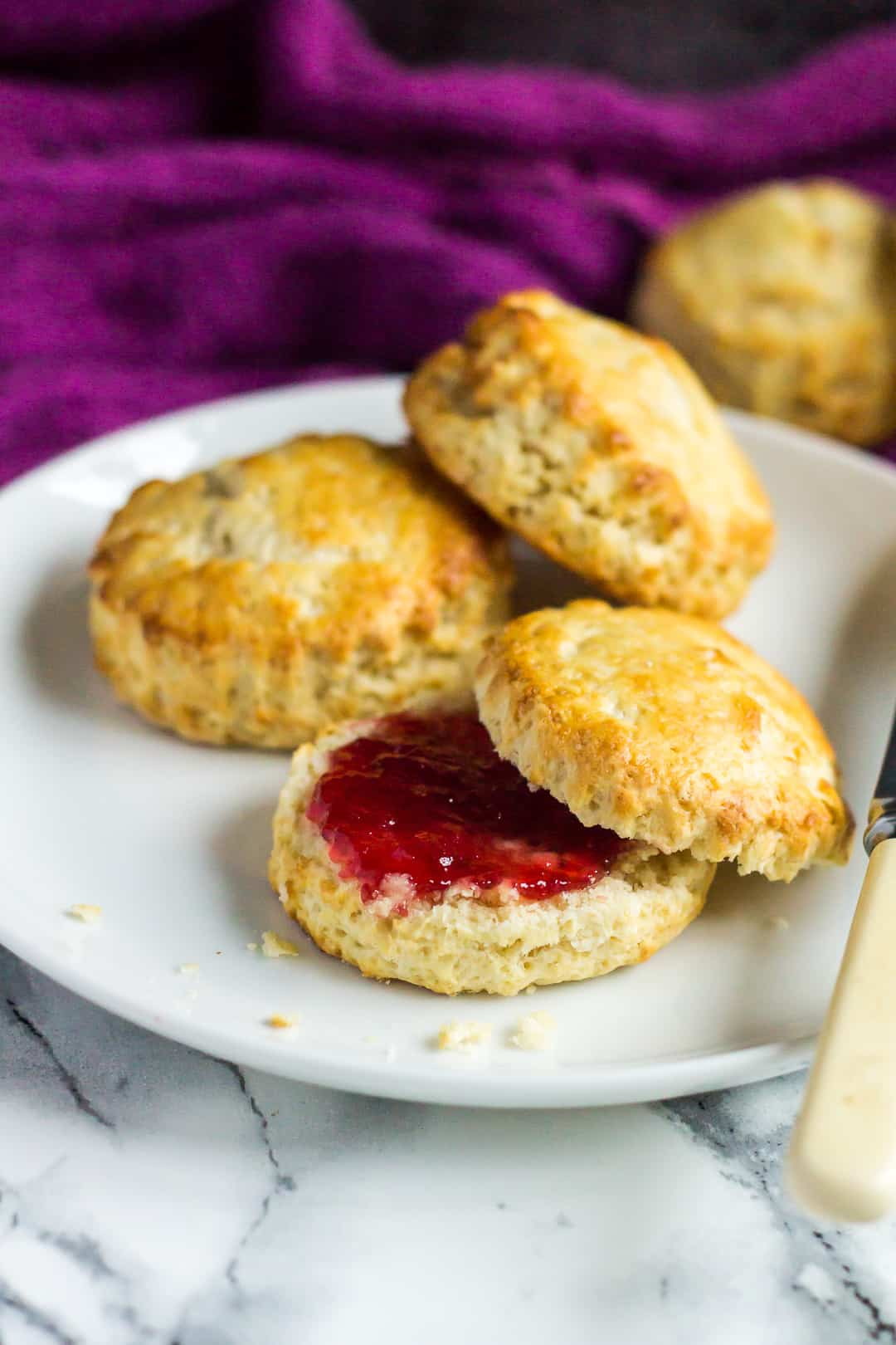 Classic English Scones served on a small white plate.