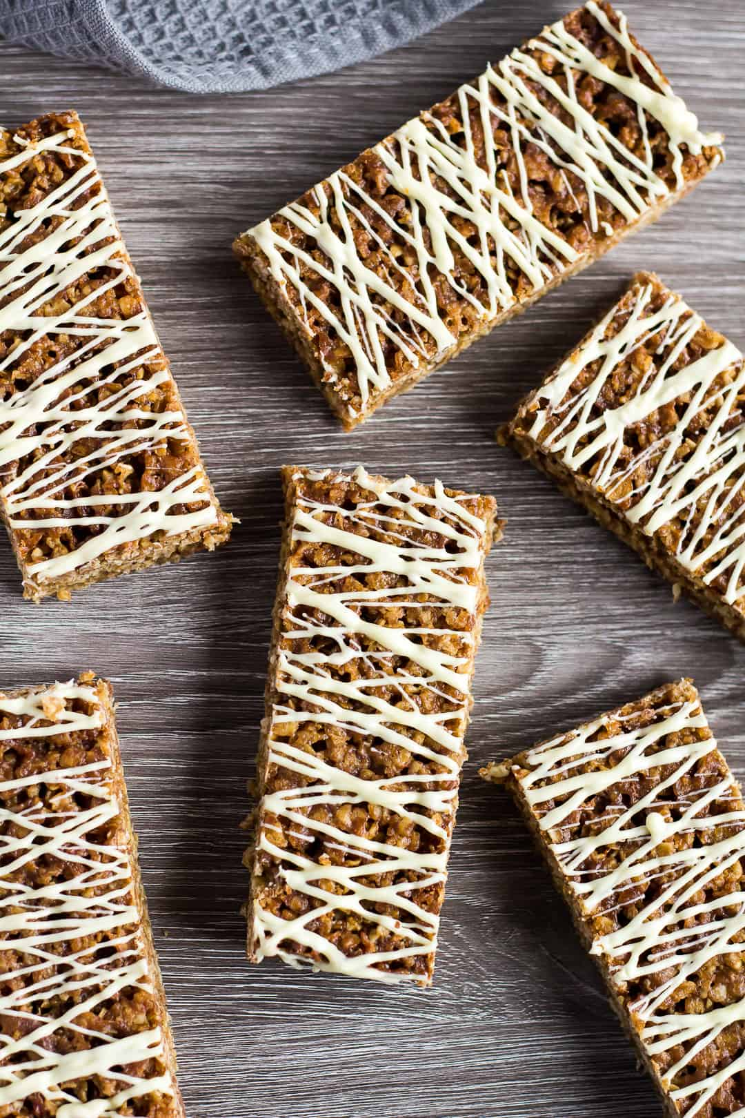 An overhead shot of Hot Cross Bun Spiced Flapjacks drizzled with white chocolate.