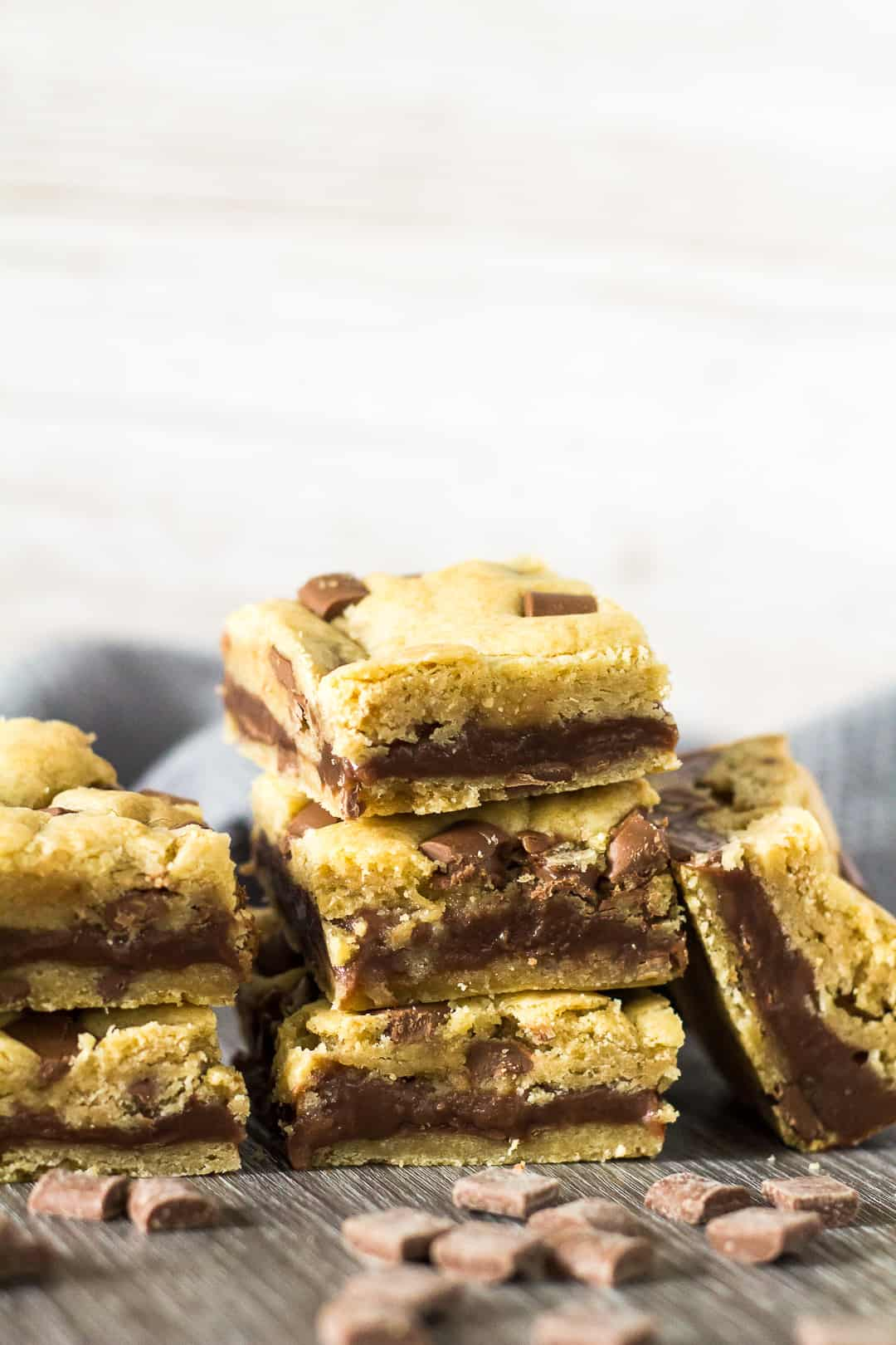 A stack of Fudge Stuffed Chocolate Chip Cookie Bars.
