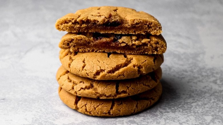 A stack of cookies showcasing their jam centres.