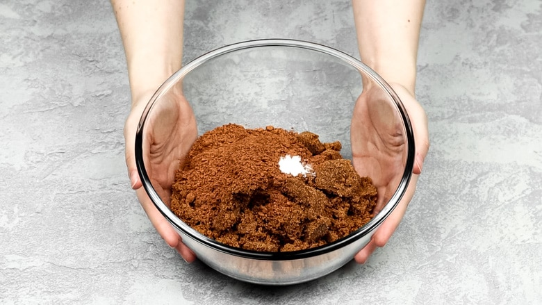 Chocolate, oil, sugar, cocoa powder, and salt in a mixing bowl.